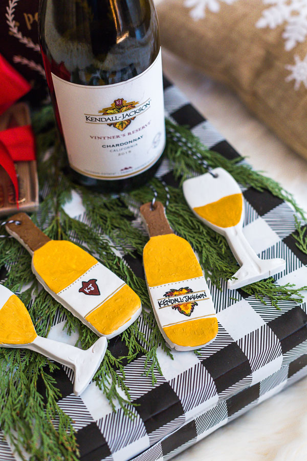DIY holiday clay ornaments next to real wine bottle