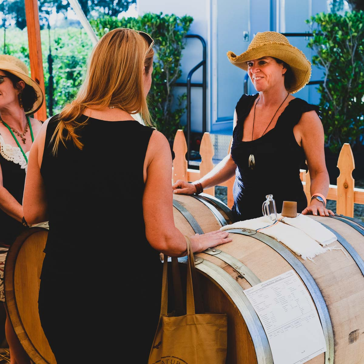 Sampling wine from barrels