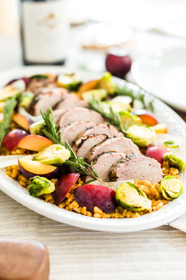 Enjoy the flavors of fall with this grilled pork loin, served over a bed of farro withroasted harvest vegetables and ripe plums.