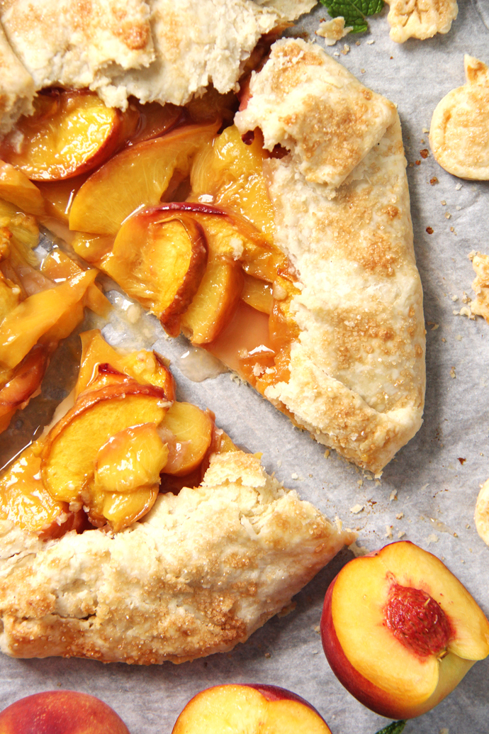 This Rustic Honey Peach Galette so much easier and less fussy to assemble than a traditional top and bottom pie crust. #recipe