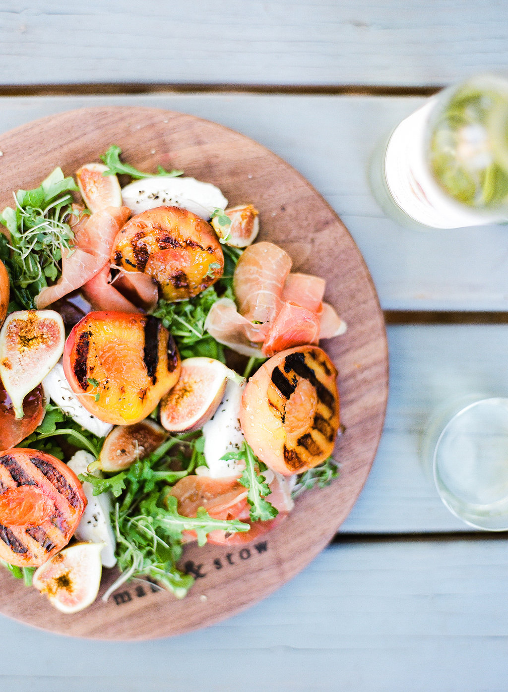 This Grilled Peach & Prosciutto Salad has that summertime citrus we all crave, it's hearty enough to satisfy even the most staunch salad nay sayers, and it's just about the perfect dish for any occasion - specifically a backyard bash!