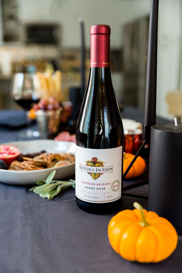 Between the witches, goblins and bats there's still plenty of fun in a bottle of wine and a decadent, Spooky Halloween Wine & Cheese Board for your friends.