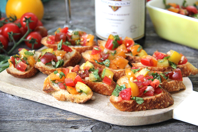 Bruschetta is one of the easiest and quickest appetizers to make!  You can have this Tomato Basil Bruschetta recipe made and ready to serve in less than 30 minutes, so it's great for last minute get-togethers and large crowds.