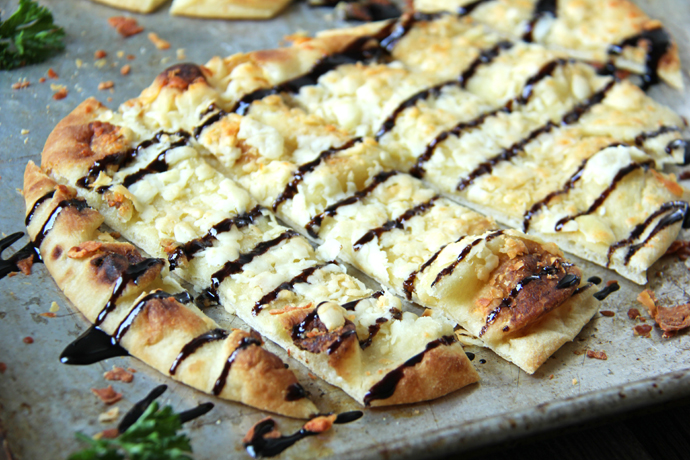 This parmesan naan bread recipe is so easy to put together which makes it perfect for last minute get togethers with friends, or when ever you feel the need for a cheesy, garlicky bread to snack on!