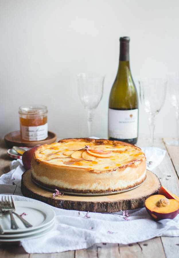 For this recipe, I've taken my favorite New York-style cheesecake and layered it with spiced peach compote to bring out the notes of peach in the wine. And since peaches and pecans compliment each other so perfectly, I added pecan pieces to an otherwise traditional graham cracker crust for a little bit of southern flair and added texture.