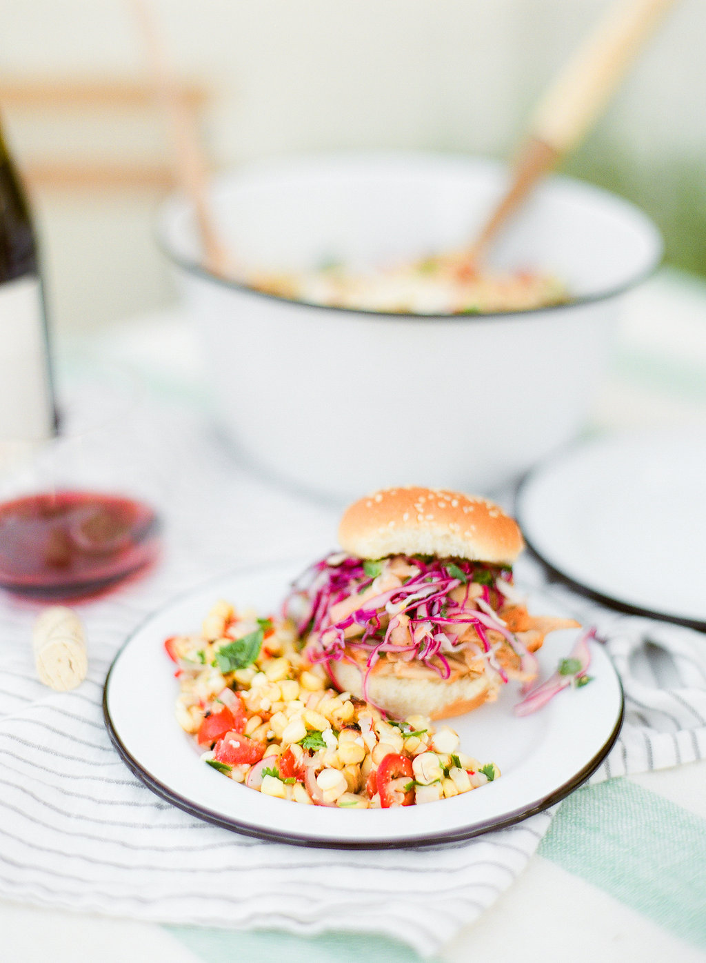 This pulled pork sliders & jalapeno and pineapple slaw recipe is perfect for a backyard bash, summer potluck or dinner party.