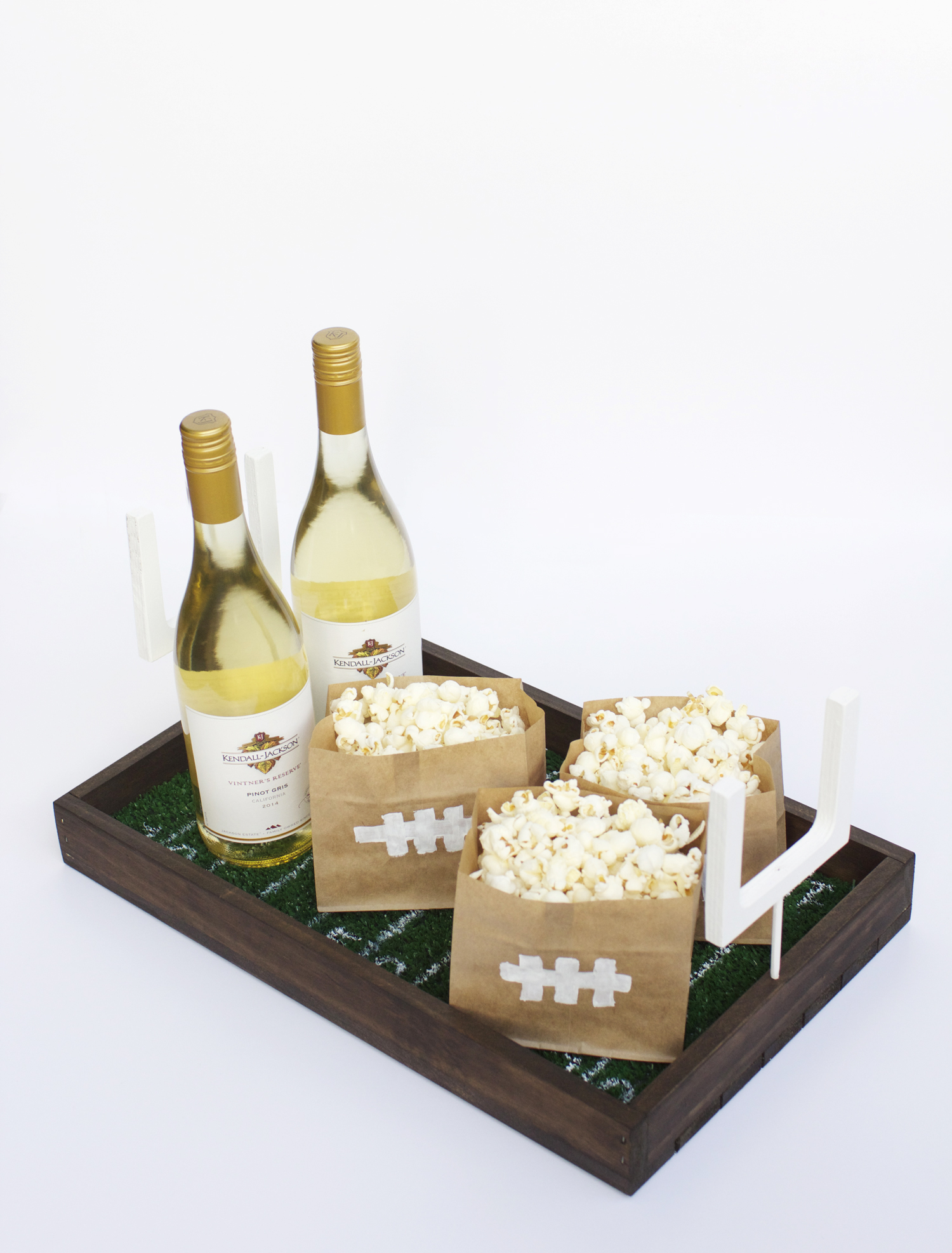No matter which team you're rooting for, this DIY football field serving tray will make your snacks and wine feel even more special.
