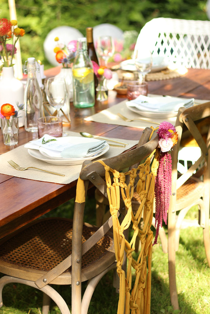 The concept was a dinner party at dusk in the countryside. We wanted to keep things fairly simple and casual but I couldn't resist adding a pop of color and a crafty touch with these pretty macrame chair hangings. #DIY