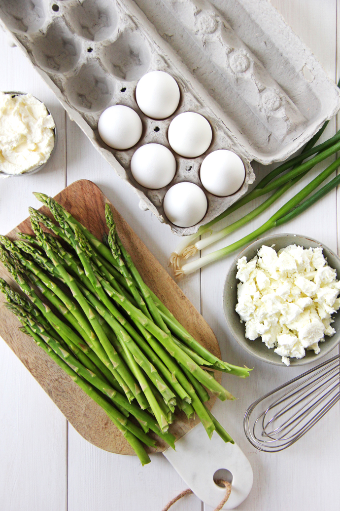 Simple, fresh ingredients make up this breakfast favourite... asparagus, eggs, goat cheese, ricotta cheese and green onion.  Combined, they result in this easy and delicious Asparagus Goat Cheese Frittata.