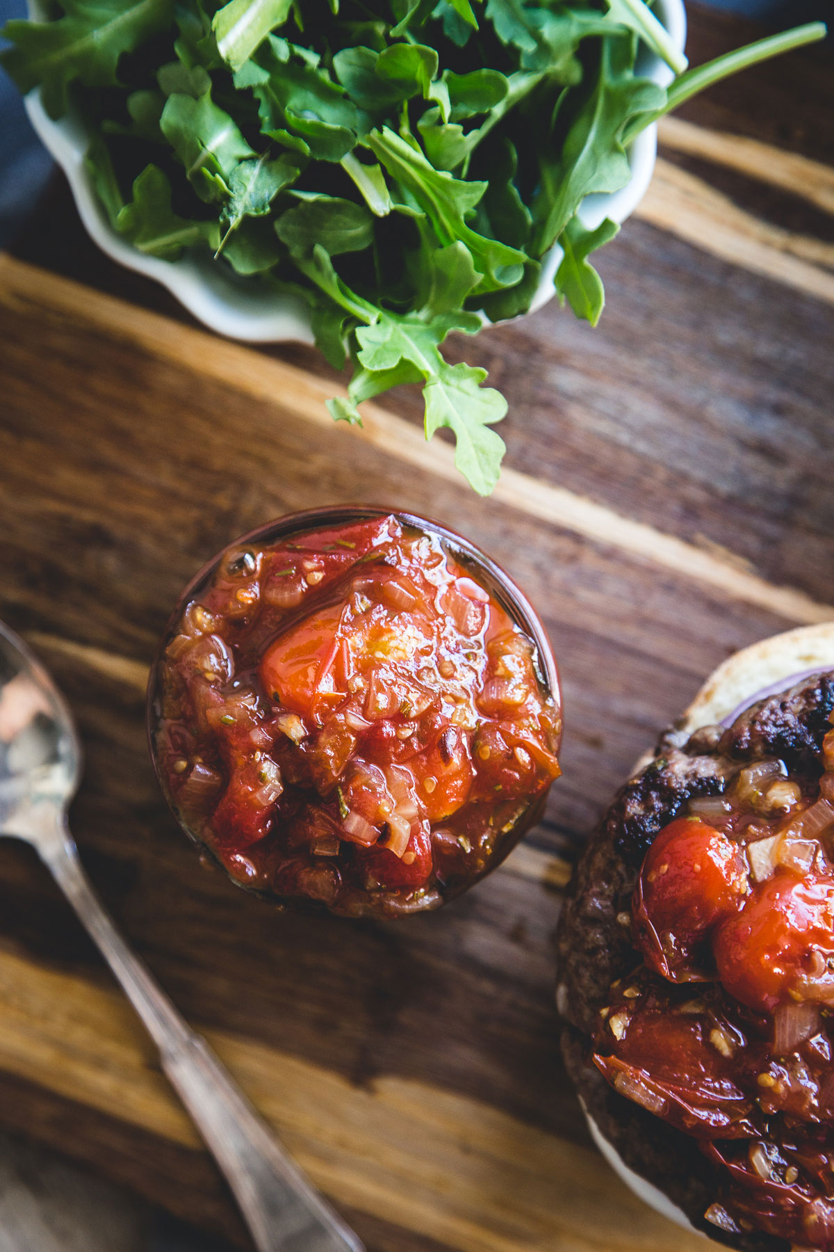 We like to serve this tomato jam as an accompaniment for grilled lamb burgers or salmon. It is also nice for a bruschetta with soft cheese.