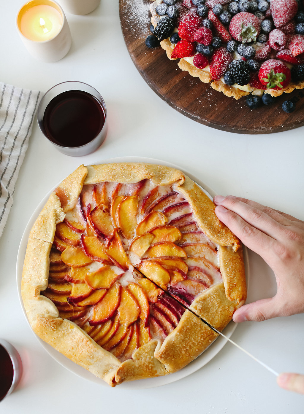 Lighter than most pies (thanks to a thinner crust), fun to make, and packed full of your favorite fruit — the galette has quickly won it's way into our hearts, potlucks, and even an afternoon treat. #recipe #dessert