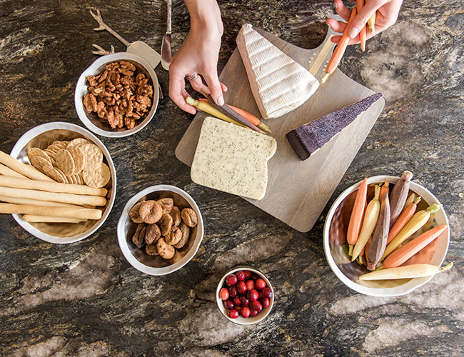 Who doesn't love a cheese board? Here is how to craft a beautiful cheese board that everyone will enjoy — paired perfectly with your favorite wines.