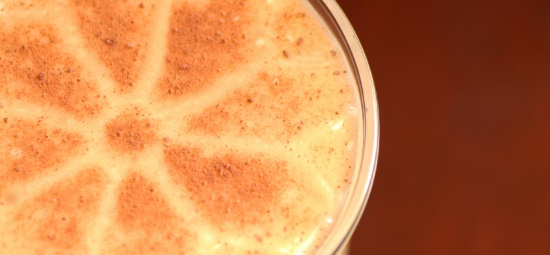Overhead view of glass of eggnog with nutmeg