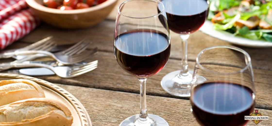 Why does wine taste better with food?