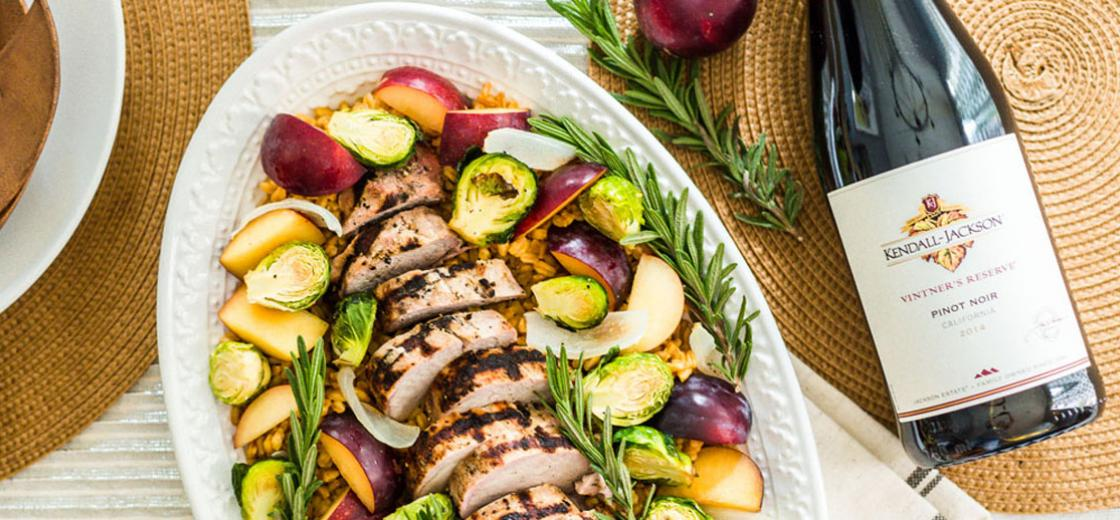 Enjoy the flavors of fall with this grilled pork loin, served over a bed of farro with roasted harvest vegetables and ripe plums.
