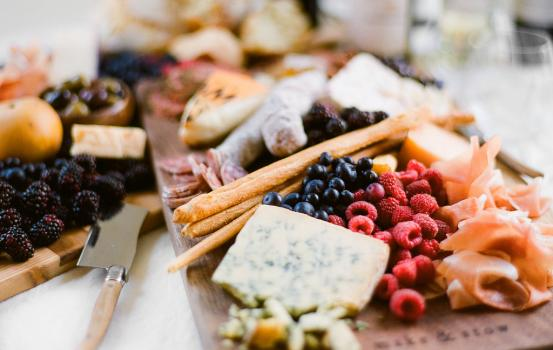 My favorite thing about a wine tasting party is the prep. That might sound weird, but it's fun to put a big beautiful board together full of different fruits, cheeses, proteins, and treats. My approach to building a beautiful spread is to pack it all on. That way your guests can try new flavor pairings, experience something unique, and it makes finding the perfect wine pairing that much more fun.