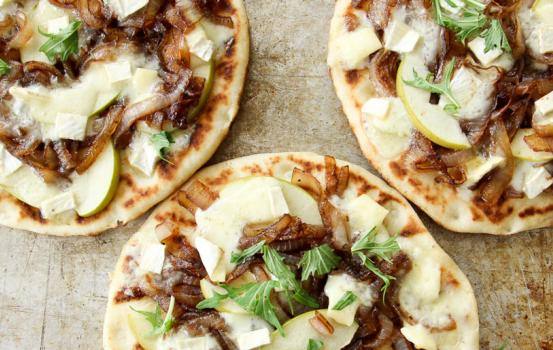 This Caramelized Onion, Apple and Brie Flatbread recipe is an ideal summer appetizer for an outdoor bbq or to enjoy as a personal entree for yourself.