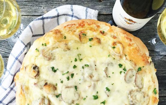 Today, it's all about pizza. And not just any pizza, this is a recipe for White Pizza with Chicken, Mushrooms and Mozzarella. A recipe that is perfect when served up with a glass of Kendall-Jackson Vintner's Reserve Chardonnay.